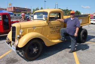 Tom Miller with his father John and the 1935 Ford at a recent antique truck show at the Nebraska Crossing outlet mall near Gretna. Before customization as a roads department truck, it had to lose four feet and a corn sheller.