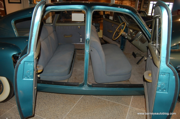 """Suicide"" doors reveal the interchangeable front and back seats."