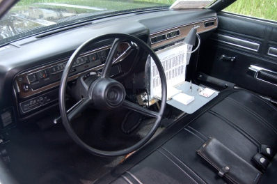 "To authenticate the interior, Houts added the ""hot sheet"" desk, radiator-hose holsters for nightsticks in the doors, and a rack against the seat front to hold a replica shotgun."