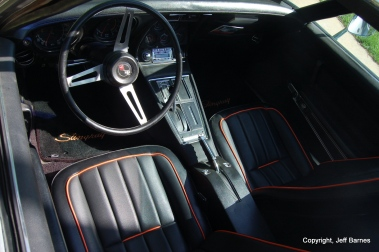 A friend did the interior to match the paint job's tangerine stripe. Floor mats complete the theme.