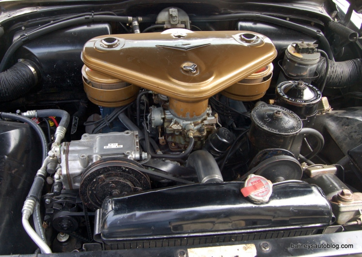 "The 365 c.i. V-8 engine has the Cadillac El Dorado set-up with two four-barrel carburetors and a ""batwing"" air cleaner."