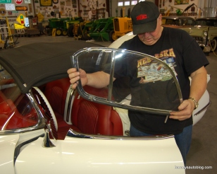 Janssen demonstrates the installation of the car's side windows.